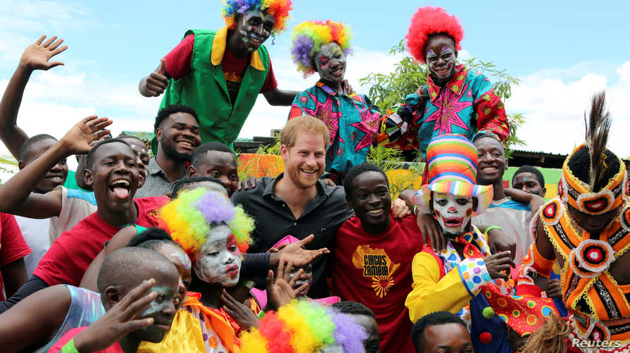 Youths pose for a photograph with Britain's Prince Harry during his visit to Circus Zambia in Lusaka, Zambia, Nov. 27, 2018.