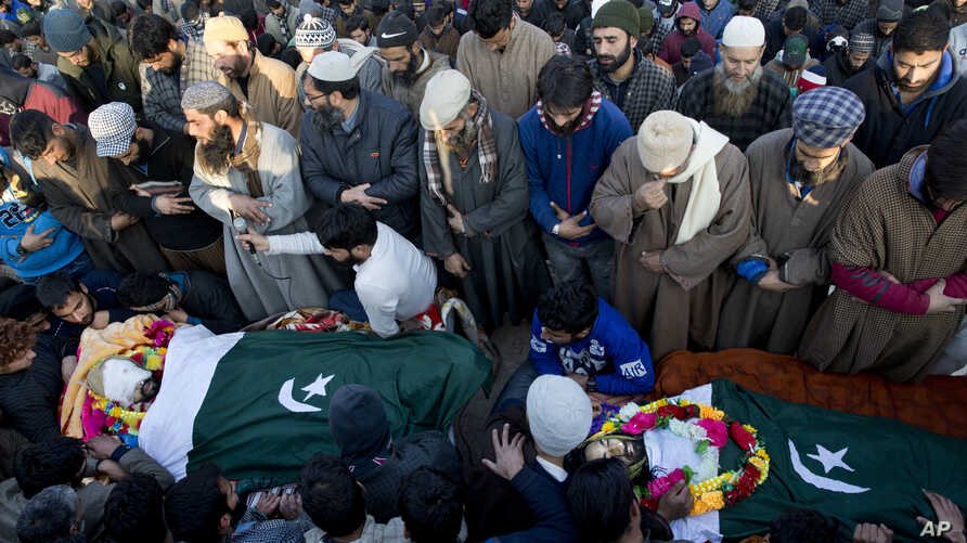 Kashmiri villagers offer joint funeral prayers for a civilian Abid Lone, right, and local rebel Adnan Ahmed in Pulwama, south of Srinagar, Indian controlled Kashmir, Dec. 15, 2018.