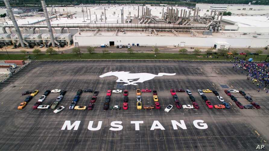 "Photo provided by the Ford Motor Co., shows Mustang vehicles parked to spell out ""10,000,000"" on a parking lot at the Flat Rock Assembly plant, Aug. 8, in Flat Rock, Mich."