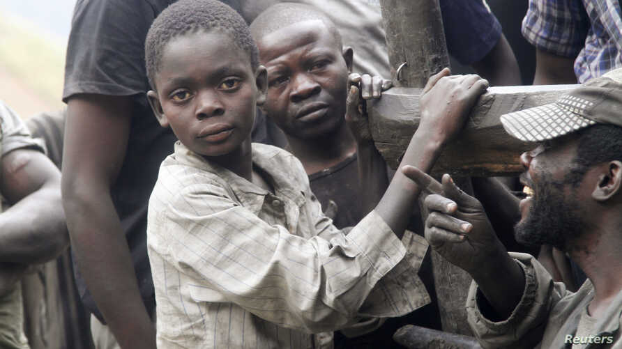 Boys take a break from panning for gold at the Marco gold mine in Mukungwe locality, Congo, May 9, 2014.