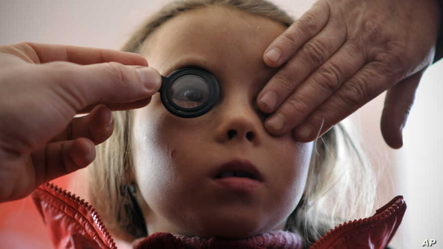 FILE - A girl's eyes are examined March 8, 2012.