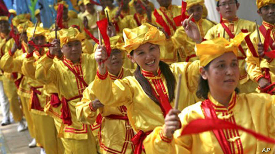 Falun Gong practitioners play instruments during a protest in front of the Chinese Embassy in Jakarta, Indonesia (2010 File)