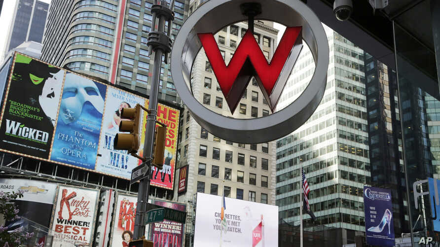 FILE  - The logo for the W Hotel, owned by Starwood Hotels & Resorts Worldwide, is seen in New York's Times Square, July 31, 2013.