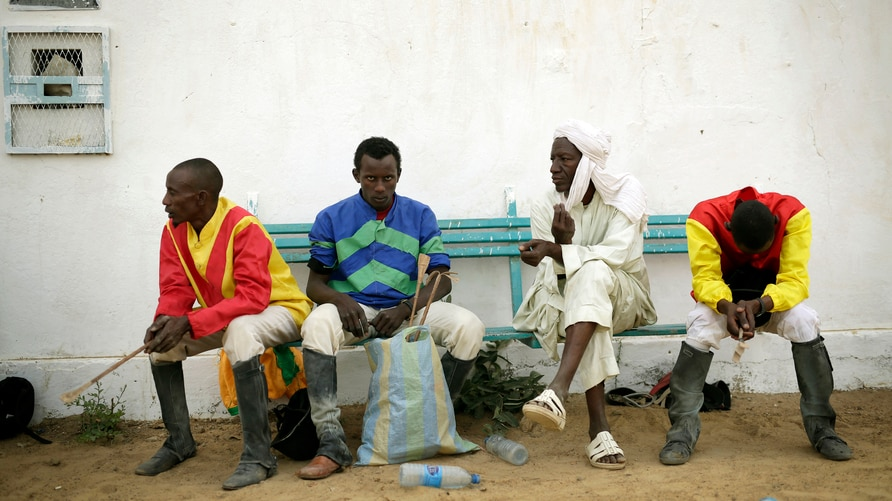 Chadian jockeys wait to race during an afternoon of races at the hippodrome in N'djamena, Chad, Sunday March 15, 2015. Horse races take place every Sunday, bringing hundreds of spectators willing to brave the excruciating heat to watch their favorite