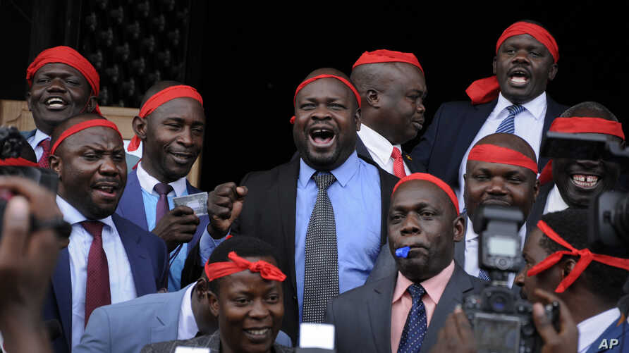 Ugandan Members of Parliament opposed to the extension of presidential age limits, wear red bandanas which they said signified their willingness to die in defence of the constitution, at the Parliament building in Kampala, Uganda, Sept. 21, 2017.
