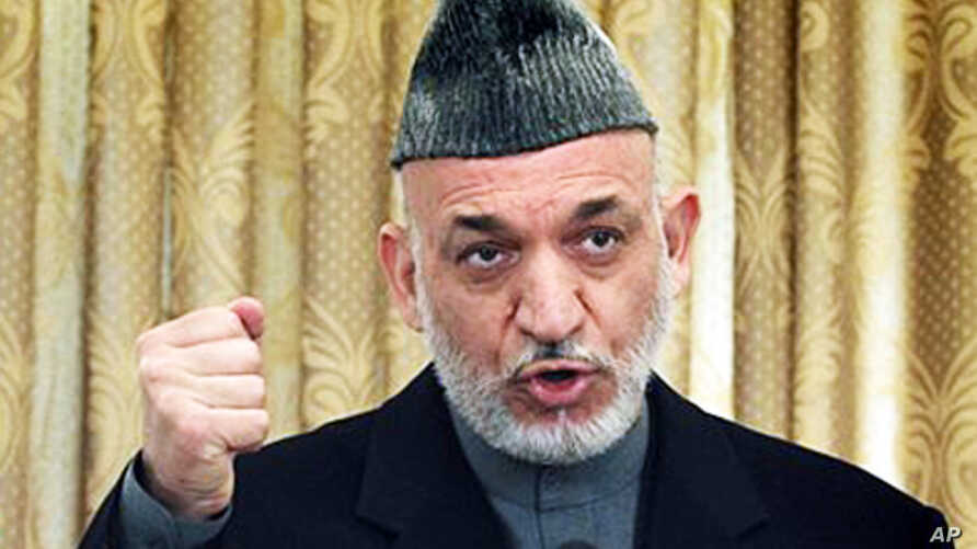 Afghan President Hamid Karzai speaks during a press conference in Kabul, February 08, 2011