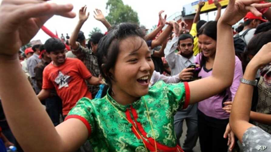 A Unified Communist Party of Nepal (Maoist) supporter dances during an indefinite nationwide general strike by Maoist in Kathmandu on 2 May 2010
