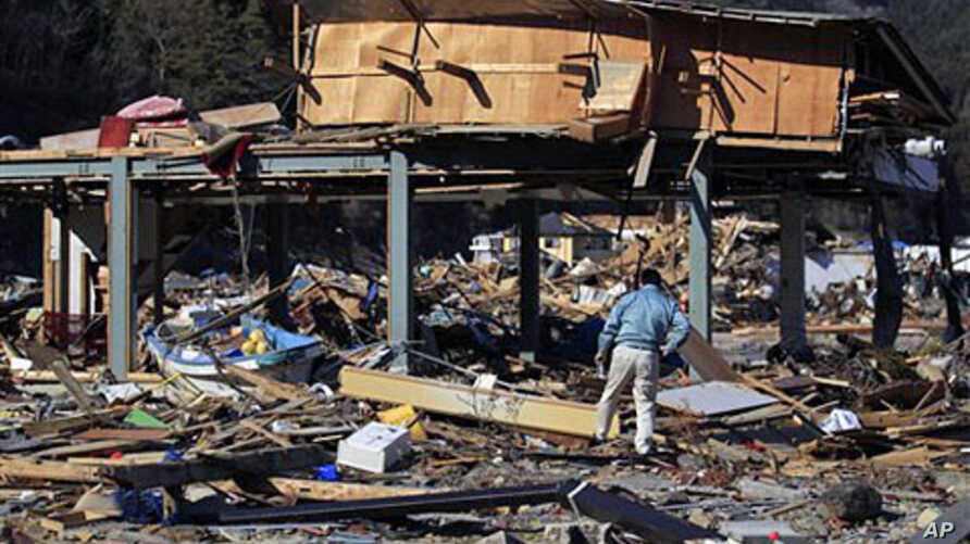 Masahiko Horio, president of Horio Seisakushou Co., Ltd, walks around the remains of a subcontract factory destroyed by the March 11 tsunami waters at Ogatsu town in Ishinomaki, Miyagi Prefecture, northern Japan. (Mar 2011 file photo)