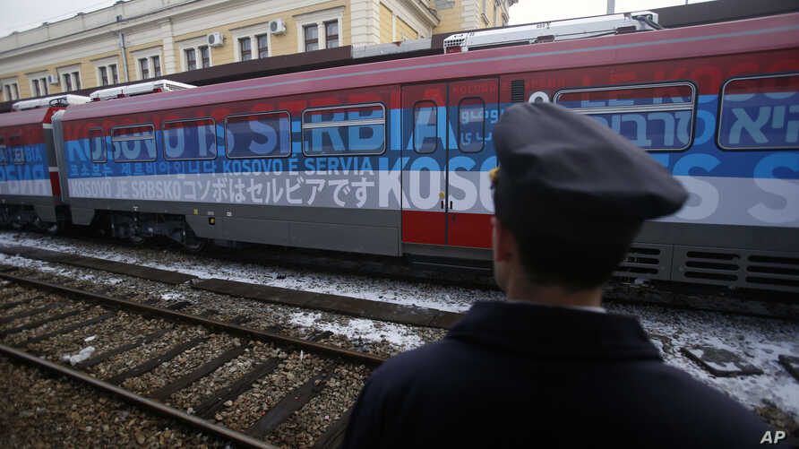 "A railroad worker stands by the first train decorated with letters that read ""Kosovo is Serbian"" written in twenty languages departing from Belgrade to Mitrovica, Kosovo, Jan. 14, 2017."