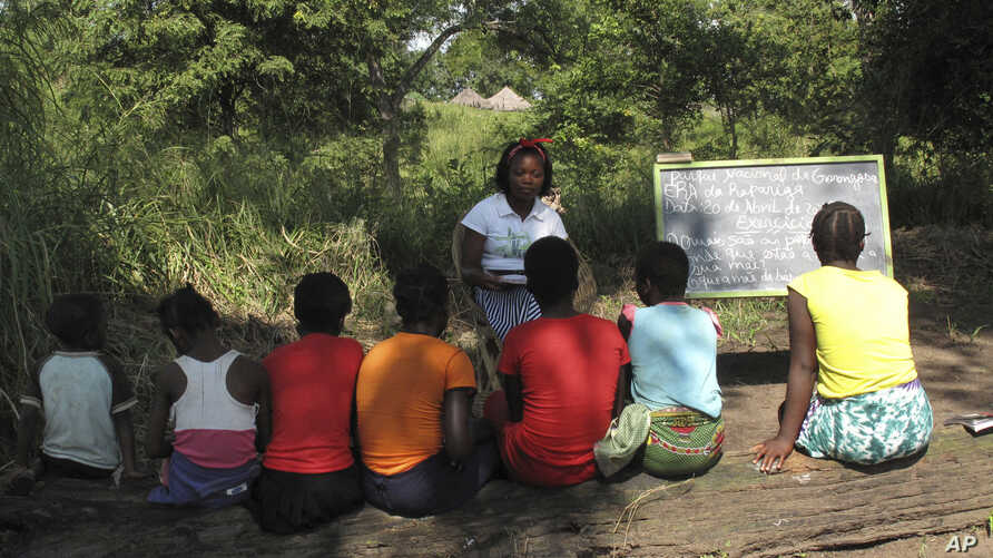 FILE - Photo taken in the Gorongosa National Park, Mozambique, shows Mozambican girls participating in a program that aims to help them stay in school longer and avoid child marriage, a longstanding problem in the southern African country, April 20,