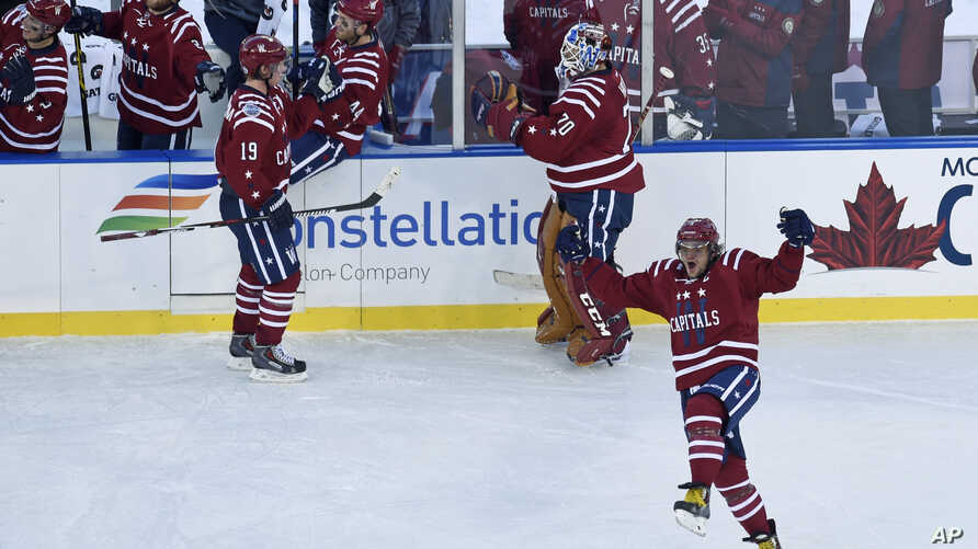 Washington Capitals left wing Alex Ovechkin, right, celebrates the game-winning goal by teammate Troy Brouwer near the end of the NHL Winter Classic at Nationals Park in Washington, Jan. 1, 2015.