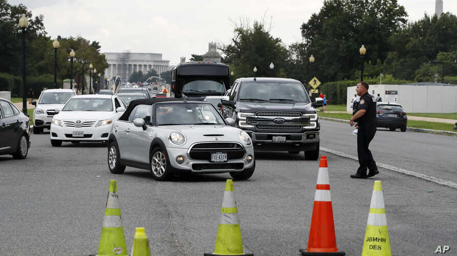 Cars are turned away from the entrance of Arlington National Cemetery, in Arlington, Va., Aug. 22, 2018.