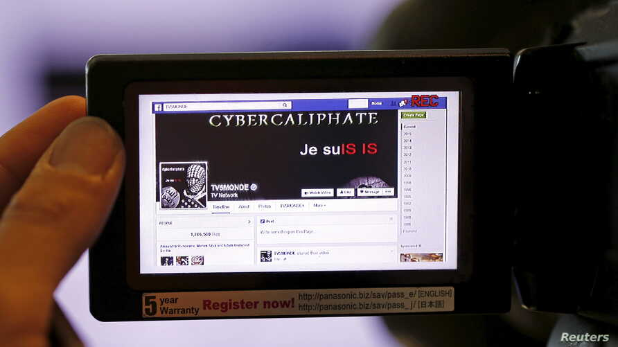 FILE - A screen grab of a hacked Facebook page of a French television network is seen on a camera viewer in Paris, April 9, 2015. U.S. Internet giants reached a deal with the EU Tuesday on ways to quickly tackle instances of online hate speech.