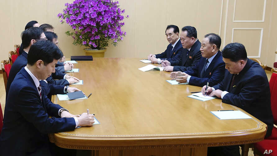 In this photo provided by South Korea Presidential Blue House via Yonhap News Agency, Kim Yong Chol, vice chairman of North Korea's ruling Workers' Party Central Committee, second from right, talks with South Korean delegation in Pyongyang, North Kor...