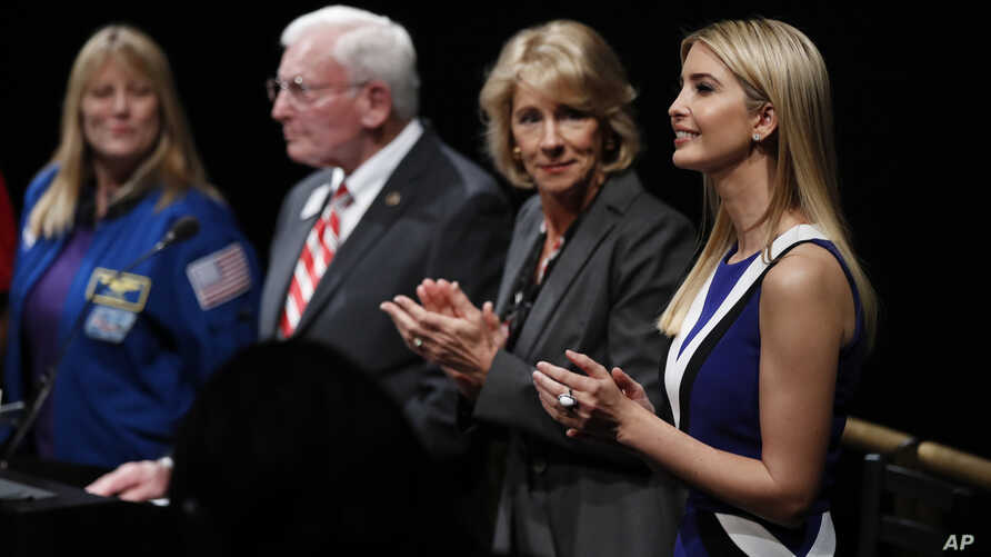 "From right, Ivanka Trump, Education Secretary Betsy DeVos, John R. ""Jack"" Dailey, director of the National Air and Space Museum and NASA Astronaut Kay Hire, applaud at the Smithsonian's National Air and Space Museum in Washington, Tuesday, March 28,"