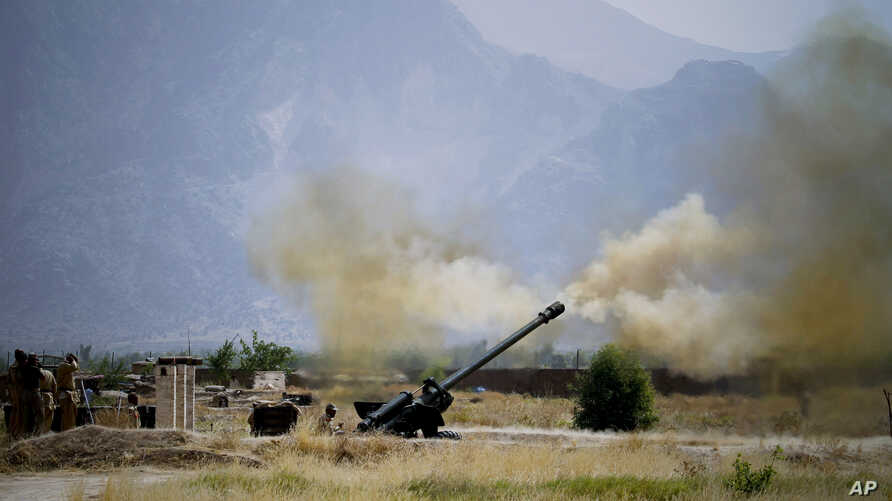 FILE - IN this June 1, 2011, file photo, Pakistani troops fire heavy artillery toward alleged militants hideouts in mountain ranges along the Afghan border.