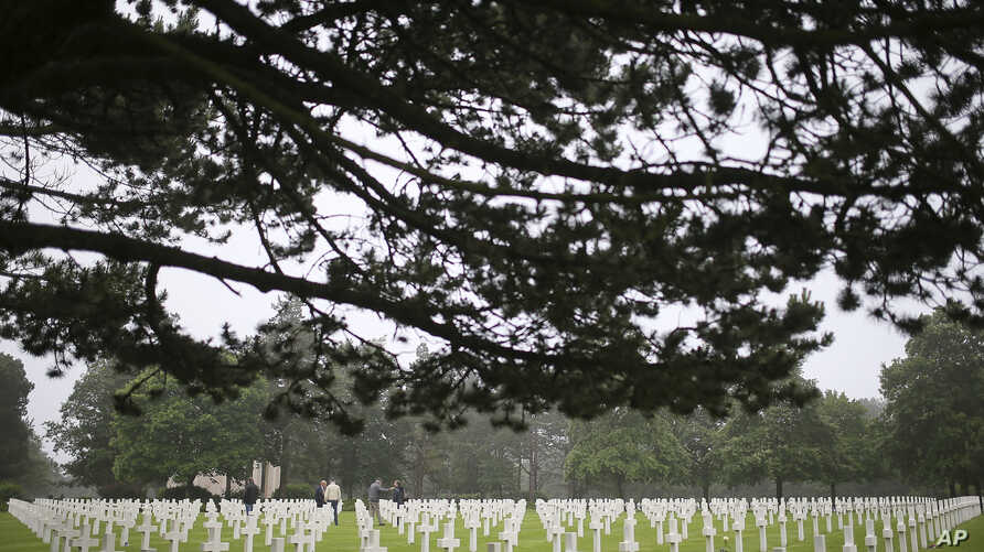 FILE - A general view of the headstones at the Colleville American military cemetery, in Colleville sur Mer, western France, June 6, 2018, on the 74th anniversary of the D-Day landing.