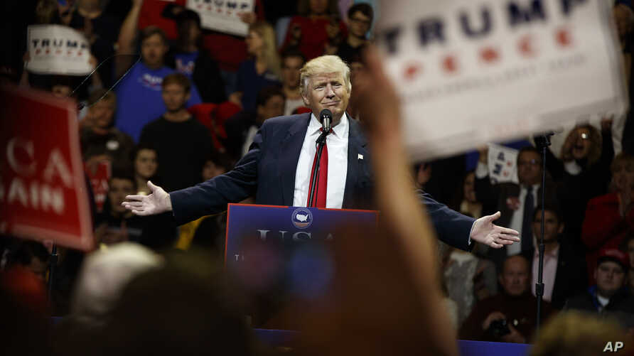 """President-elect Donald Trump gestures as he speaks during a """"USA Thank You"""" tour event, Dec. 1, 2016."""