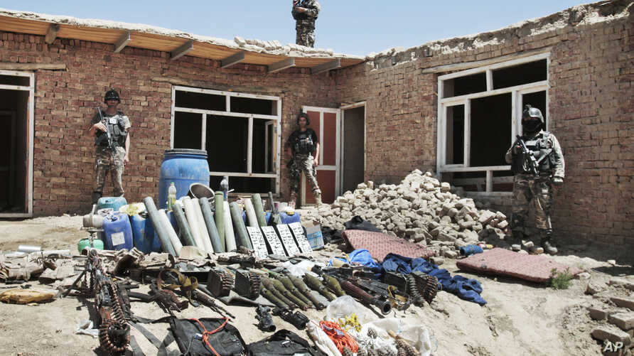 Arms and ammunition belonging to militants are displayed after they were killed during a gun battle with Afghan security forces on the outskirts of Kabul, Afghanistan, Aug. 2, 2012.