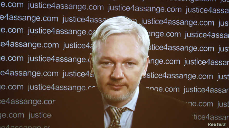 WikiLeaks founder Julian Assange appears on screen via video link during a news conference at the Frontline Club in London, Britain Feb. 5, 2016.