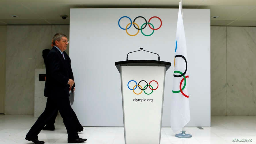 FILE - International Olympic Committee (IOC) President Thomas Bach arrives to announce the 2022 Olympic Winter Games candidate cities at the IOC headquarters in Lausanne, July 7, 2014.