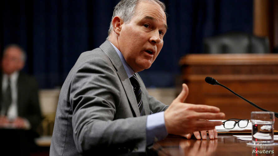 FILE - Scott Pruitt, Environmental Protection Agency administrator, gestures as he testifies to the Senate Environment and Public Works Committee oversight hearing on Capitol Hill in Washington, Jan. 30, 2018.