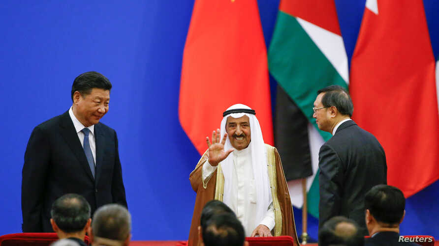 Chinese President Xi Jinping and Kuwait's Emir Sheikh Sabah Al-Ahmad Al- Jaber Al-Sabah attend a China Arab forum at the Great Hall of the People in Beijing, China, July 10, 2018.