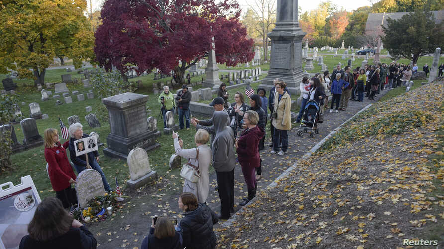 People line up to visit the grave of women's suffrage leader Susan B. Anthony on U.S. election day at Mount Hope Cemetery in Rochester, New York, Nov. 8, 2016.