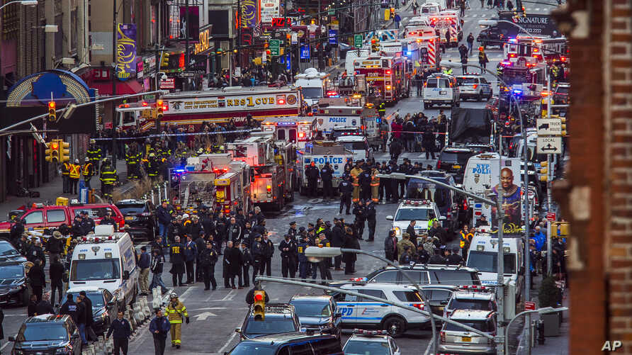 Law enforcement officials work following an explosion near New York's Times Square on Dec. 11, 2017.