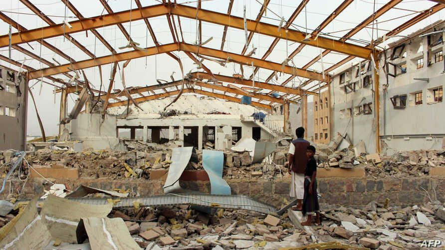 Yemenis inspect the damage caused by a Saudi-led air strike on a cholera treatment centrer supported by Doctors Without Borders (MSF) in the Abs region of Yemen on June 11, 2018.