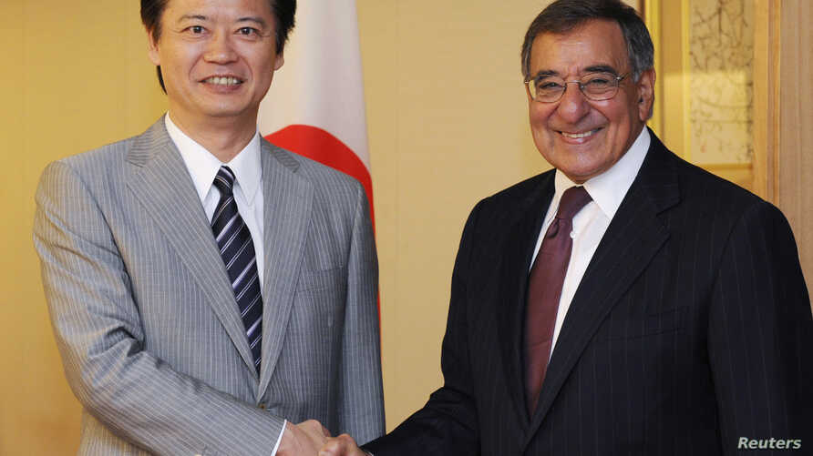 U.S. Defense Secretary Leon Panetta (R) shakes hands with Japanese Foreign Minister Koichiro Gemba at the latter's audience room in Tokyo September 17, 2012.