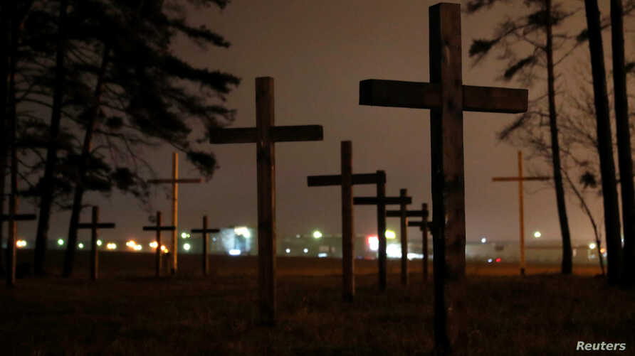 "Crosses are seen during a ""Night of the executed poets"" event at a mass grave in Kuropaty on the outskirts of Minsk, Oct. 29, 2018."