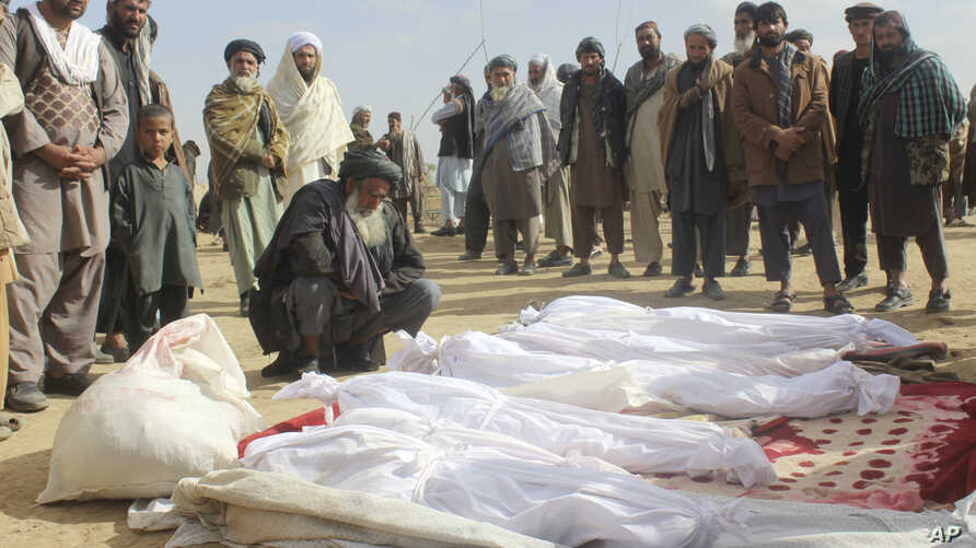 FILE -- Afghan villagers gather around several victims of clashes between Taliban and Afghan security forces in the Taliban-controlled, Buz-e Kandahari village in Kunduz province, Afghanistan, Nov. 4, 2016. In a statement released Thursday, the U.S. ...