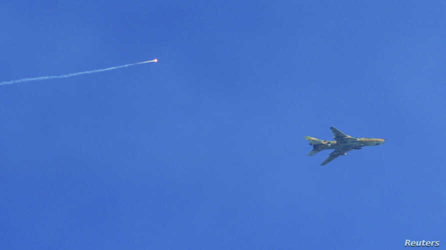 A Syrian Air Force fighter jet is seen near Damascus in this January 26, 2013, file photo (via Shaam News Network).