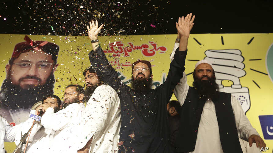 Sheikh Yaqub (C) candidate of the newly-formed Milli Muslim League party, waves to his supporters at an election rally in Lahore, Pakistan, Sept. 14, 2017.