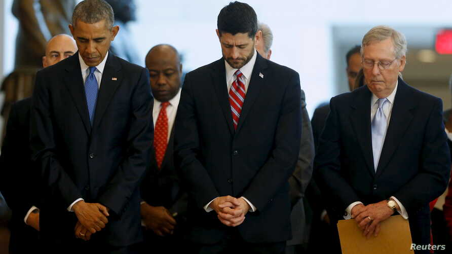 U.S. President Barack Obama (L-R), House Speaker Paul Ryan (R-WI) and Senate Majority Leader Mitch McConnell (R-KY) bow their heads in prayer at the end of a ceremony commemorating the 150th anniversary of the 13th Amendment, which formally abolished