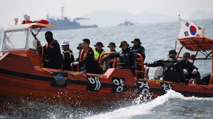 South Korean divers operate at the site where the capsized passenger ship Sewol sank in the sea off Jindo, South Korea, on April 20, 2014.