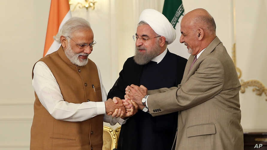 A photo released by the official website of the office of the Iranian Presidency, shows Afghan President Ashraf Ghani (R), Iranian President Hassan Rouhani (C), and Indian Prime Minister Narendra Modi, holding hands in a show of solidarity after thei