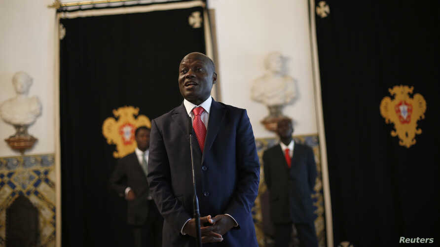 FILE - Guinea-Bissau's President Jose Mario Vaz speaks with journalists after a meeting with his Portuguese counterpart Anibal Cavaco Silva (not pictured) at Belem presidential palace in Lisbon, June 19, 2014.