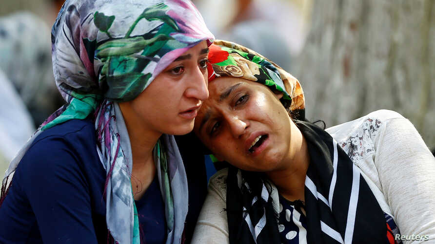 Women mourn - after a suspected bomber targeted a wedding celebration in the city, Turkey