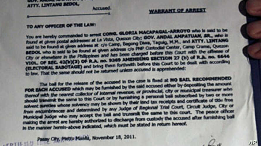 A copy of the arrest warrant served on former president and Pampanga Representative Gloria Macapagal Arroyo is shown to media at St. Luke's Medical Center in Taguig City, Manila, November 18, 2011