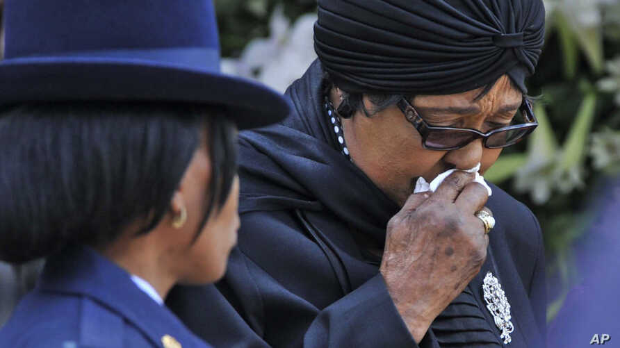 FILE - Winnie Madikizela-Mandela, Nelson Mandela's former wife, walks away after paying her respect to former South African President Nelson Mandela during the lying in state at the Union Buildings in Pretoria, South Africa, Wednesday, Dec. 11, 2013.