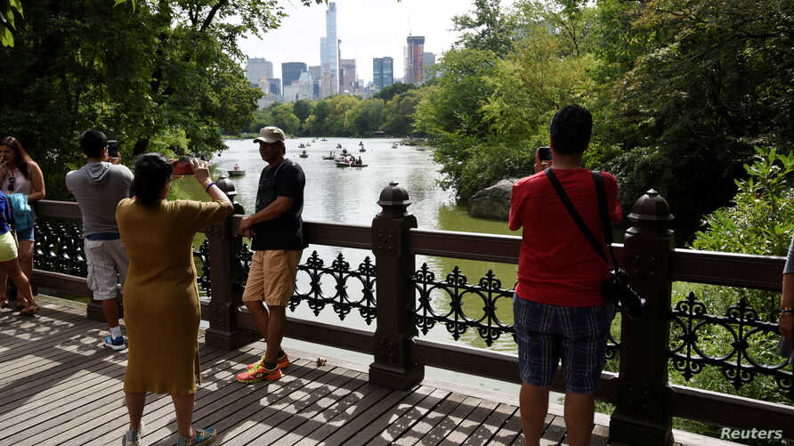 FILE - People enjoy the mild weather in Central Park at the start of the Labor Day weekend in New York, Sept. 3, 2016.