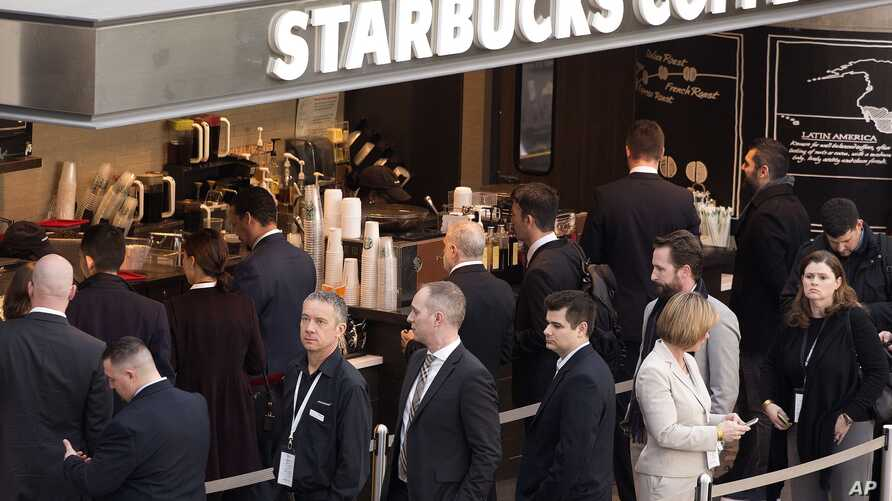 Customers line up at a Starbucks, Thursday, April 2, 2015 in New York.