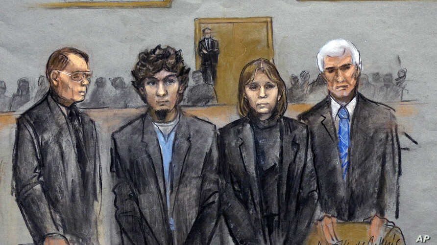 In this courtroom sketch, Dzhokhar Tsarnaev (2nd from Left) is depicted standing with his defense attorneys William Fick (L) Judy Clarke (2nd from R), and David Bruck (R) as the jury presents its verdict in his federal death penalty trial, April 8, 2
