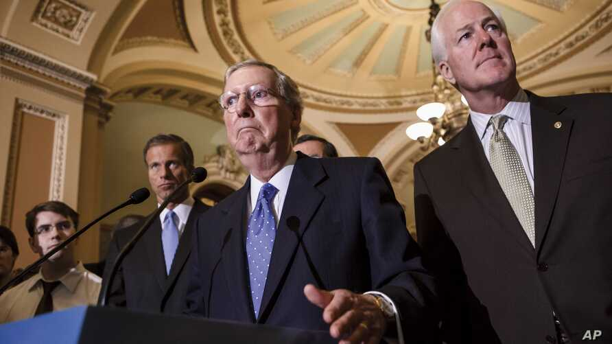 Senate Minority Leader Mitch McConnell, center, accompanied by, from left, Senators John Thune, John Barrasso and Senate Minority Whip John Cornyn, Capitol Hill, Washington, Sept. 24, 2013.