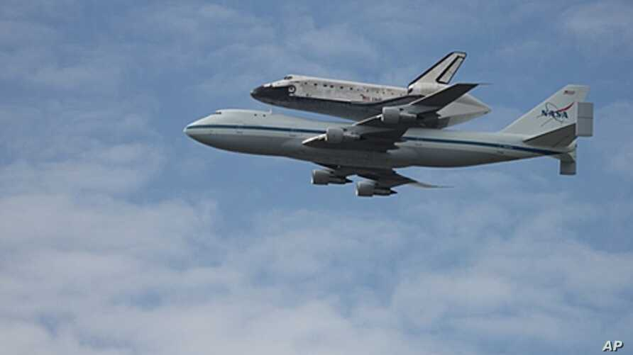 Space shuttle Discovery flown over the Washington area, April 17, 2012