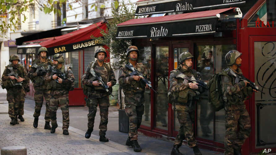 Soldiers launch operation in St. Denis, a northern suburb of Paris, Nov. 18, 2015.
