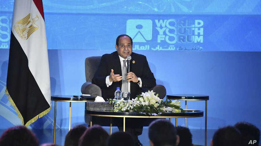 In this photo provided by Egypt's state news agency MENA, Egyptian President Abdel-Fattah el-Sissi, speaks during a youth conference in Sharm El Sheikh, Egypt, Nov. 5, 2018.