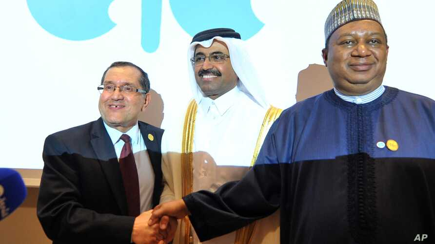 FILE -- Algerian Energy Minister Noureddine Boutarfa, left, Bin Saleh Al-Sada, Minister of Energy and Industry of Qatar, center, and acting Secretary General of OPEC Mohammed Barkindo, right, shake hands at the end of a meeting of oil ministers of th